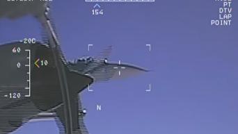 Появилось новое видео перехвата разведчика США российским Су-27. Видео
