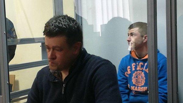 Контрактник ВСУ Владимир Балабух (на заднем плане) подозревается в убийстве человека в Киеве