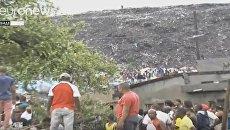 Не менее 17 человек погибли при обрушении мусора на дома в Мозамбике