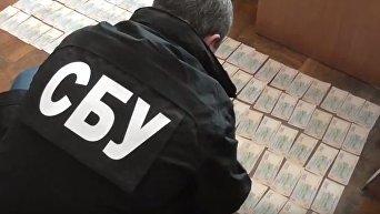 В Харькове на взятке в 150 тыс грн поймали подполковника полиции