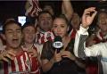 Журналистка ударила микрофоном фаната, щупавшего ее в прямом эфире. Видео
