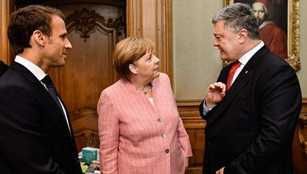 Президент Украины Петр Порошенко, канцлер Германии Ангела Меркель и президент Франции Эммануэль Макрон