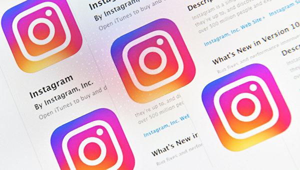 Иконки социальной сети Instagram на экране смартфона