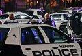 Полицейские на месте стрельбы в торговом центре Garden State Plaza в городе Парамус, США