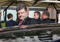 Петр Порошенко покидает встречу в нормандском формате на саммите в Милане