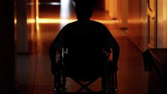 Инвалид в инвалидной коляске