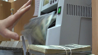 Доллары и гривны, изъятые в конвертационном центре