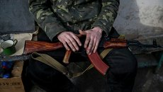 Украинский военнослужащий в зоне АТО. Архивное фото
