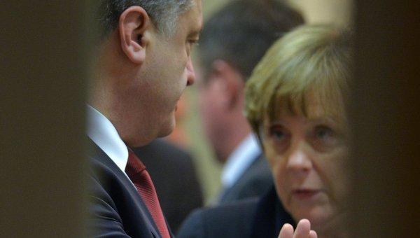 Петр Порошенко и Ангела Меркель на переговорах в Минске
