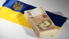 Гривны на фоне флага Украины