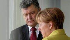 Петр Порошенко и Ангела Меркель. Архивное фото