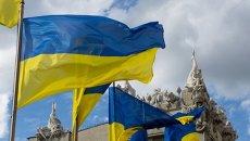 Флаг Украины на фоне Дома с химерами