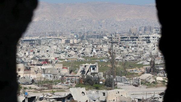 Вид на поврежденные здания в Восточной Гуте в Сирии