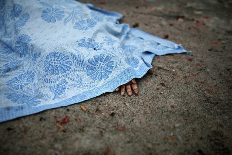 Жертва обстрела в Донецке, 30 января, 2015 г