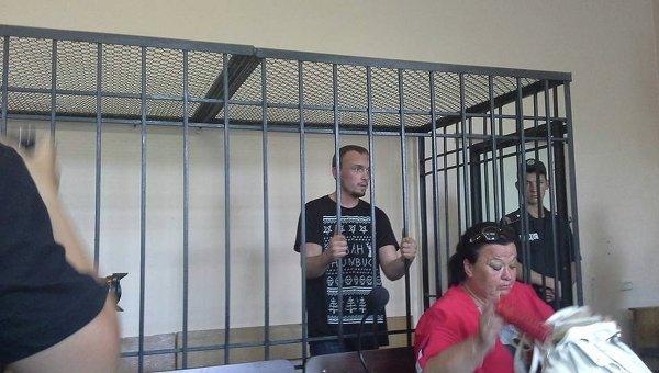 Подозреваемый в убийстве Олеся Бузины Денис Полищук на суде