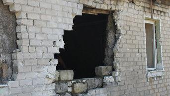 Разрушения в результате боев в Донбассе