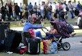 Очередь лиц, ожидающих убежища в Германии, на территории Управления здравоохранения и социальных дел в Берлине