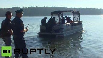 Спасатели на месте падения вертолета и гидроплана в Подмосковье