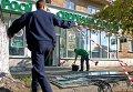 Последствия взрыва у Сбербанка России в Киеве