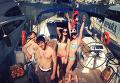 Сын народного депутата от Оппозиционного блока Евгения Балицкого Александр на яхте в Крыму с флагом РФ