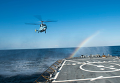 Эсминец ВМС США Дональд Кук проводит воздушную операцию с украинским вертолетом КА-27 во время учений Sea Breeze 2015