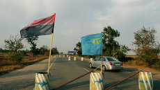 Блокада Крыма на Чонгаре: автоматчики, киевские рокеры и Курбан-байрам