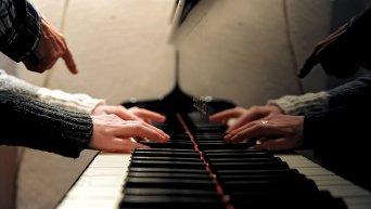 Игра на пианино. Архивное фото