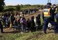 Мигранты с Ближнего Востока садятся в поезд на границе Венгрии и Хорватии.