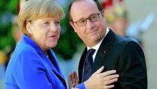Канцлер Германии Ангела Меркель и президент Франции Франсуа Олланд на встрече нормандской четверки в Париже