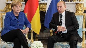 Канцлер Германии Ангела Меркель и президент РФ Владимир Путин на встрече нормандской четверки в Париже