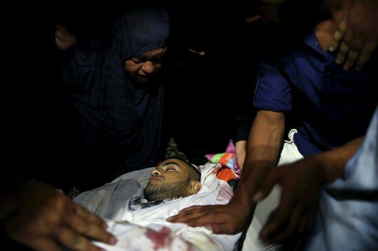 Палестинский боец убитый израильскими военными на границе Сектора Газа.