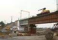 В Мариуполе восстановили взорванный мост. Видео